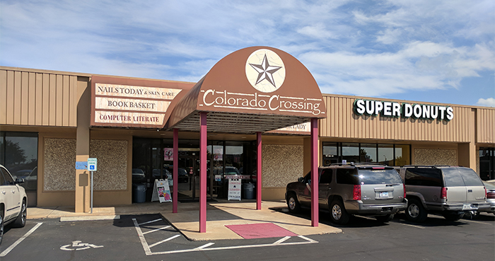 Computer Literate is located inside Colorado Crossing Mall